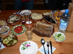 Return to Vershinino village for a traditional meal before going back to Mirny