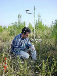 Jean-Pierre making soil moisture measurements